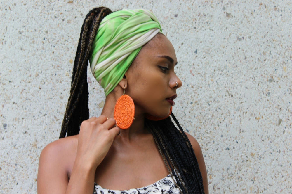 Braids are great when styling headwraps. The thinner ones particularly as they contribute to the overall styling technique. Agnes wears our tiedye headwrap MINT SPLASH (sold out) teamed with handmade raffia earrings from Yanbalala Arts.