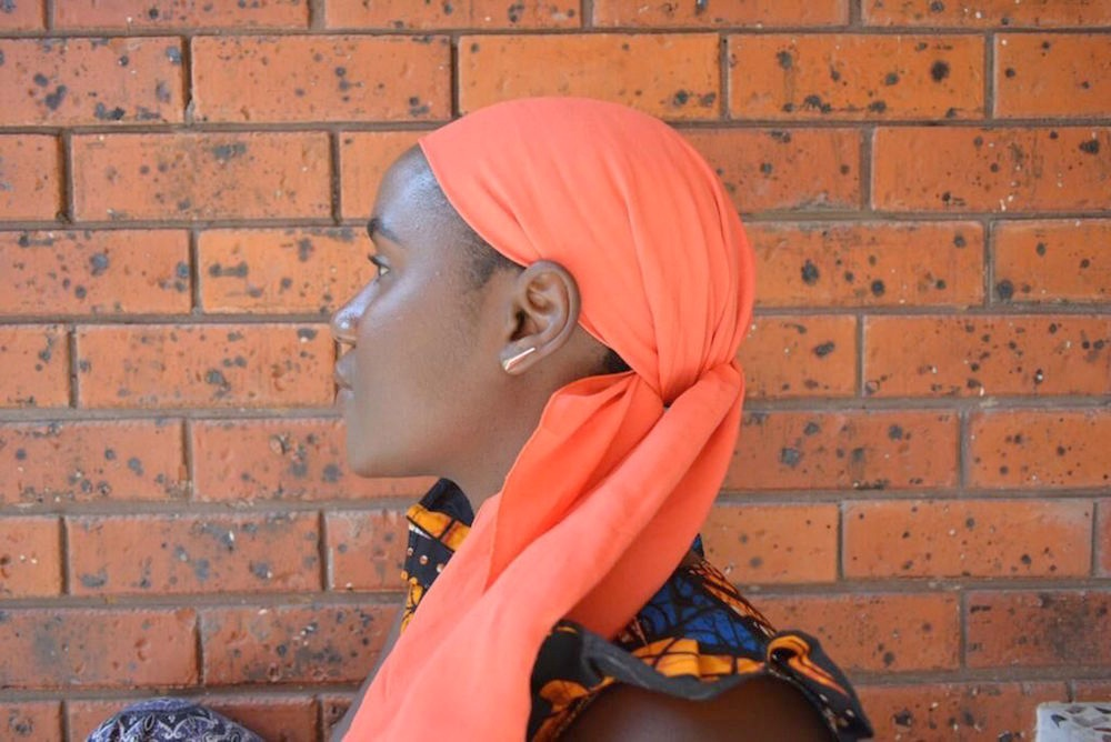 Our crepe head wrap  TANGERINE  drapes beautifully - Faro decided to style it with a simple back knot, leaving the ends free.