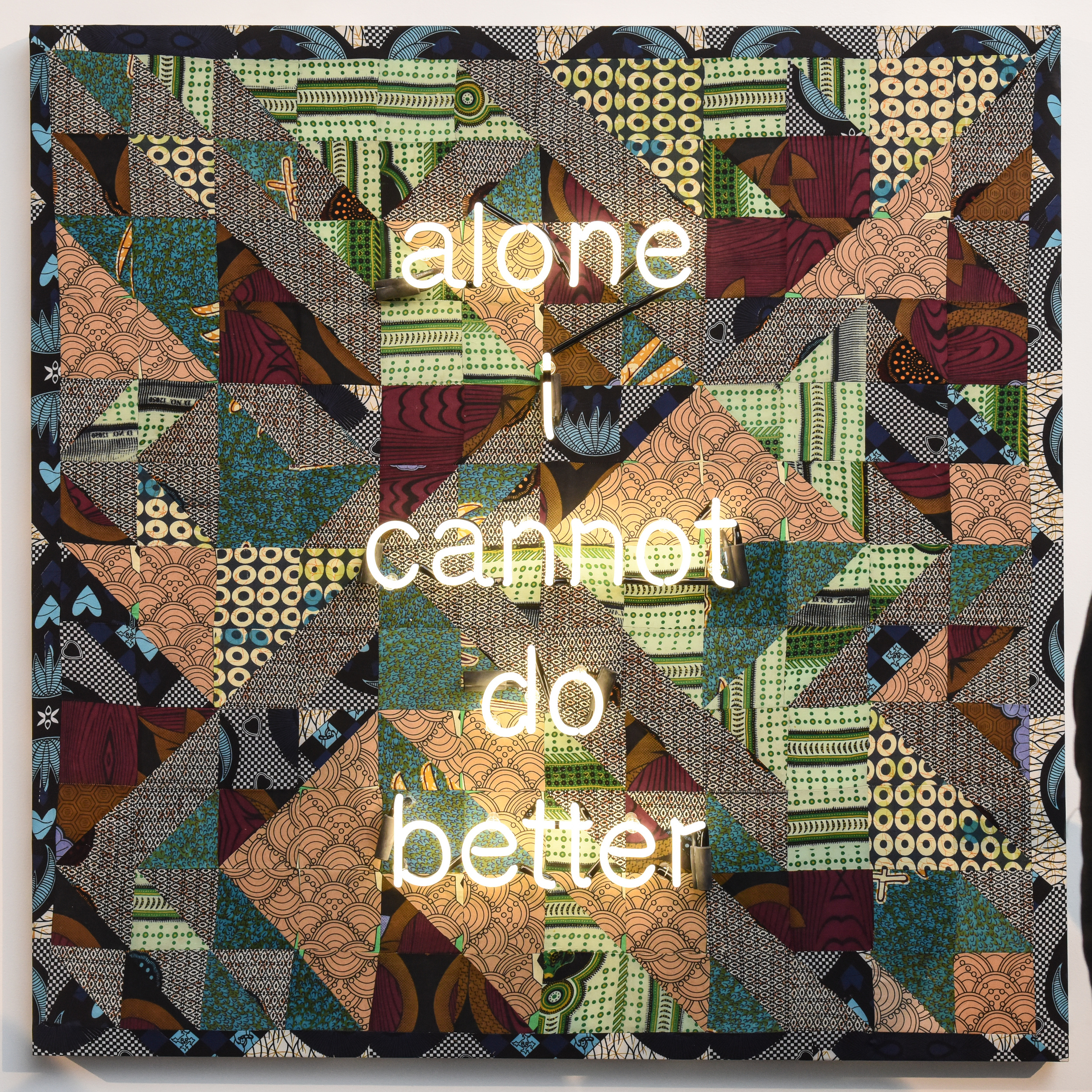 """Zoë Buckman, Alone I Cannot Do Better , 2016, Quilted fabrics and neon mounted on board, 60"""" x 60"""";Photo credit: BFA.com"""