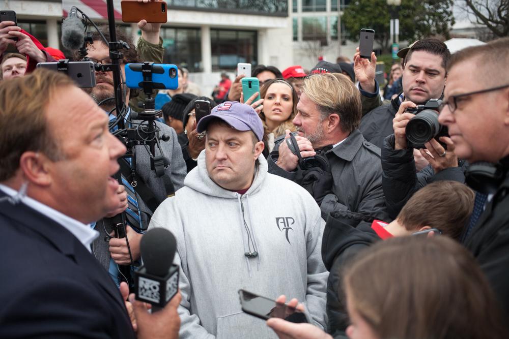A Breitbart reporter, right, asking Jones a stupid question.