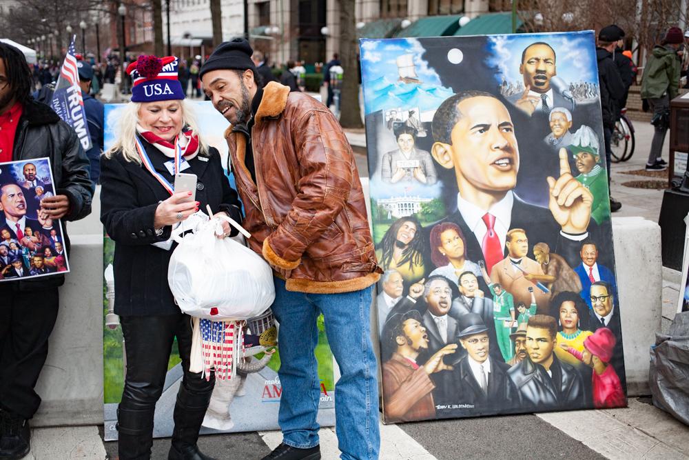 Trumpist selfie with Obama portrait artist.