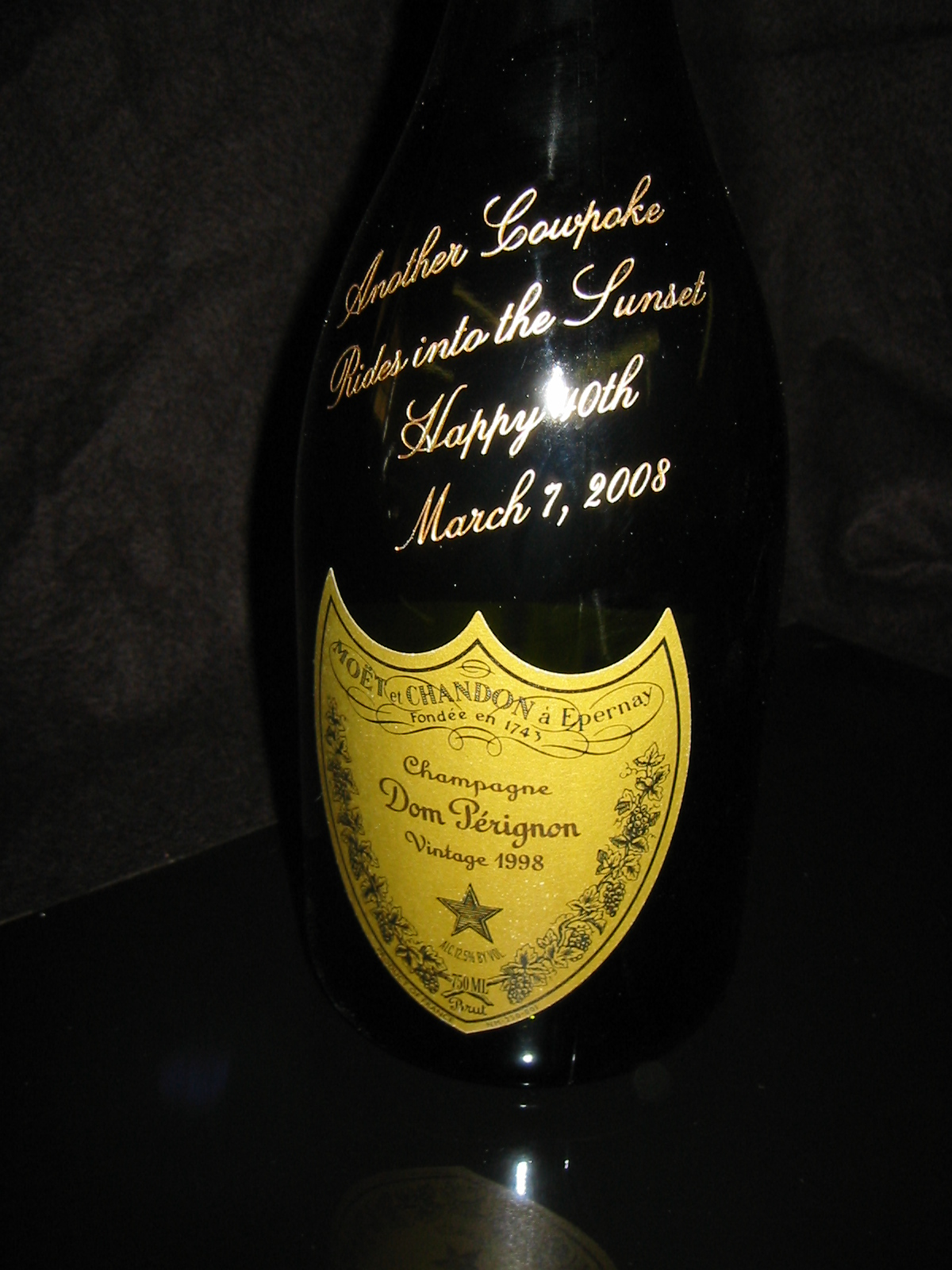 Sandblasted and paint filled champagne bottle.jpg