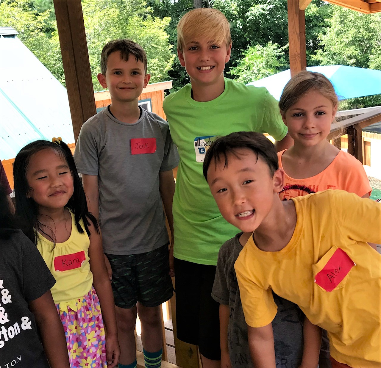 Mentor and campers on playground 2018.jpg