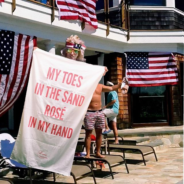 kyle cooke holding my toes in the sand rose in my hand beach towel - bravo tv summer house