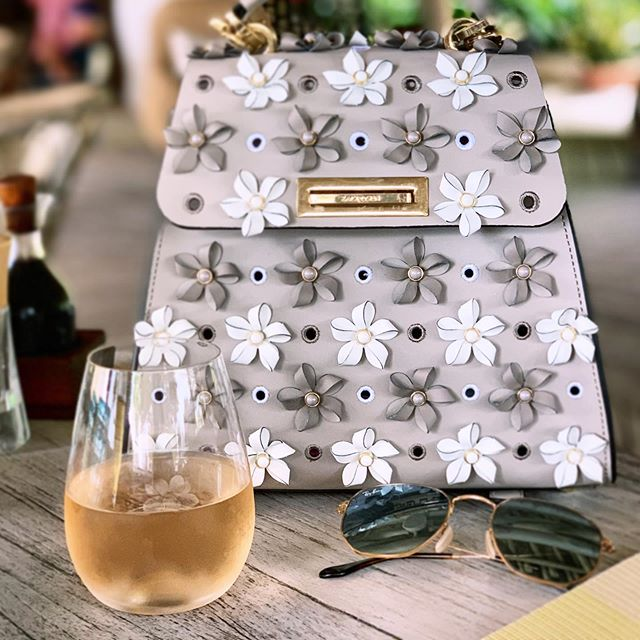 Obsessed with this @zaczacposen floral convertible backpack from @renttherunway... it's perfect for rosé season! 🎒🌹🍷 #renttherunway #zaczacposen #summervibes #roséseason