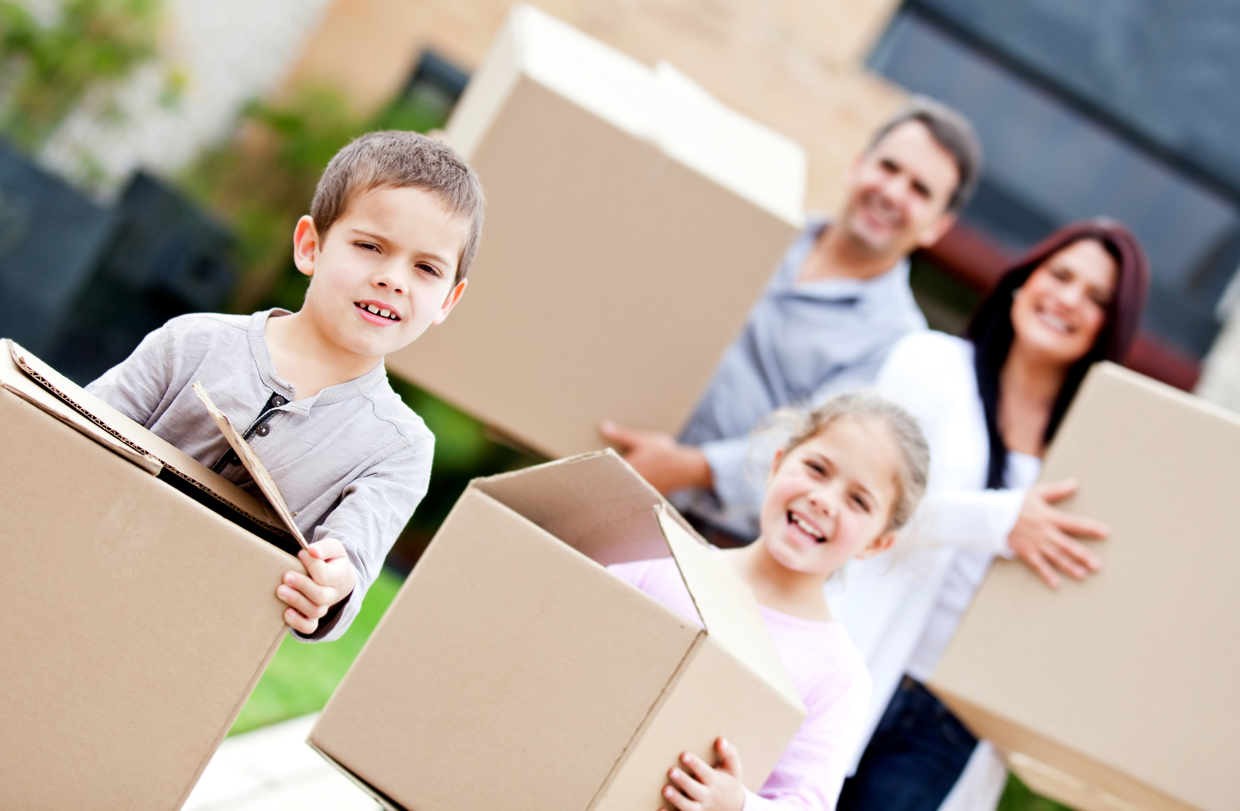 family with boxes moving to new property
