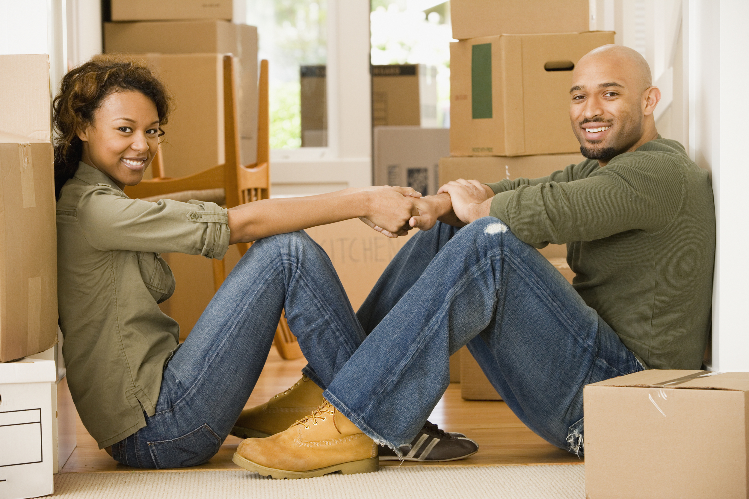 happy couple moving into new property