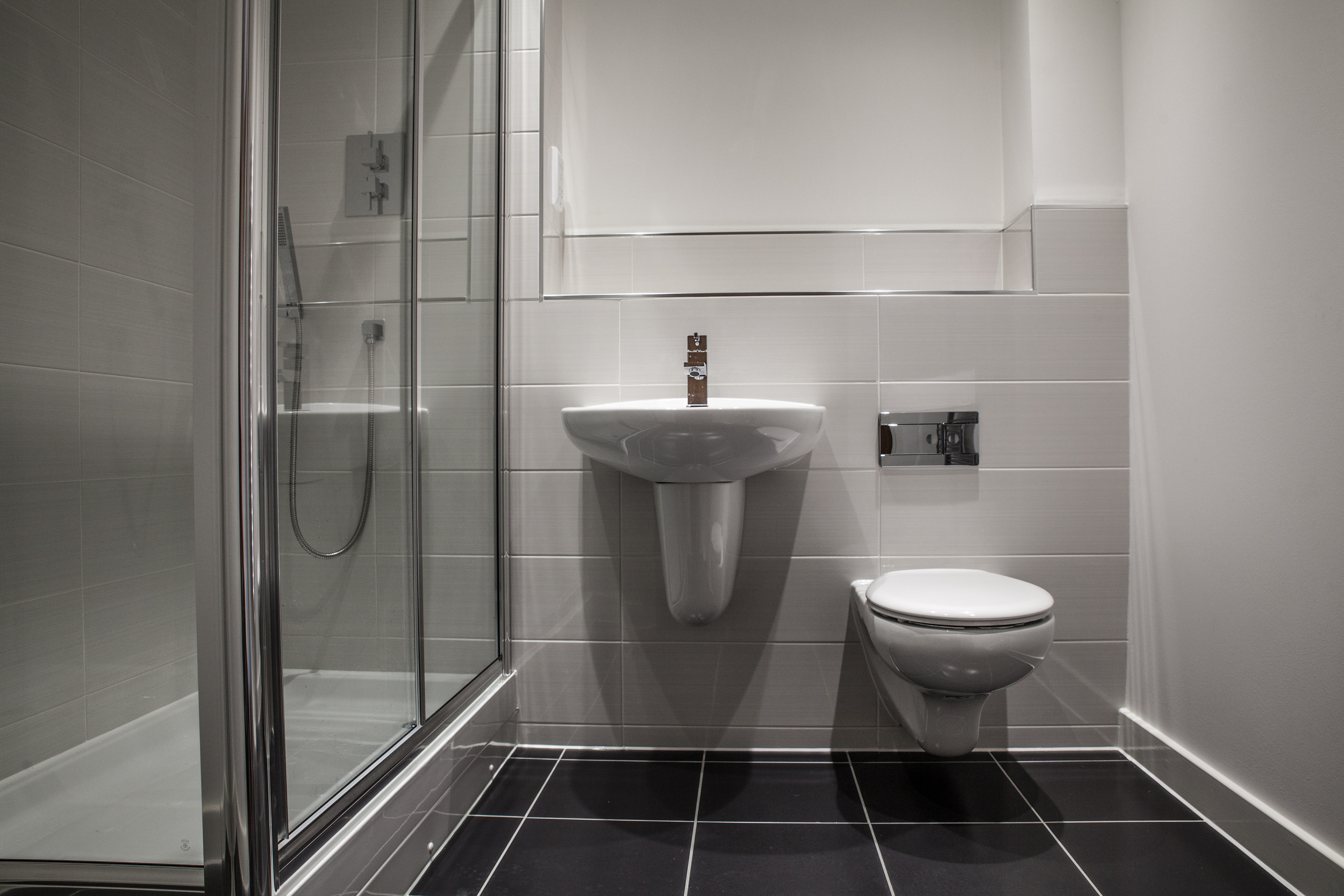 modern steel and white bathroom in new property