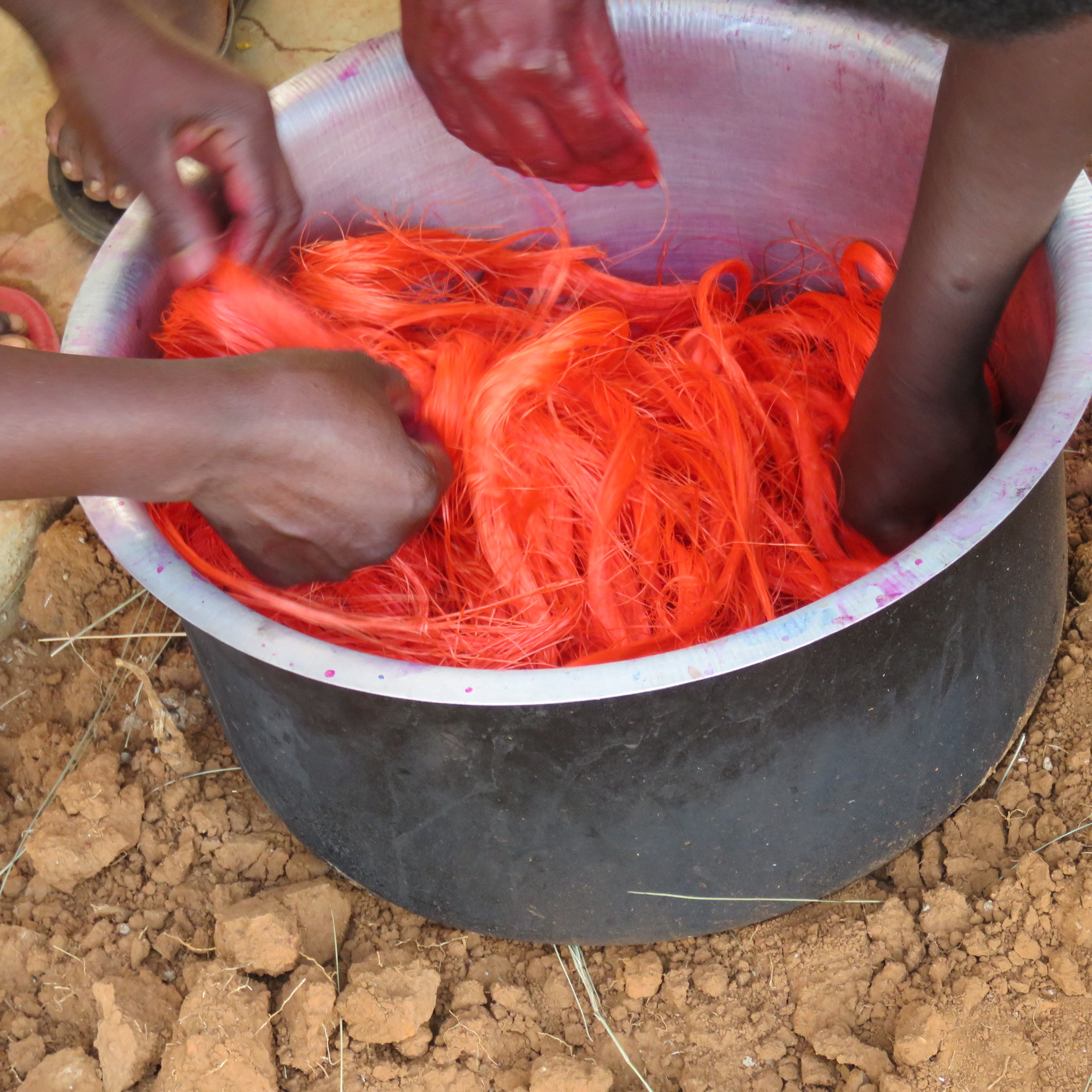 Figure 5: Stirring the fiber into the orange-coloring solution.