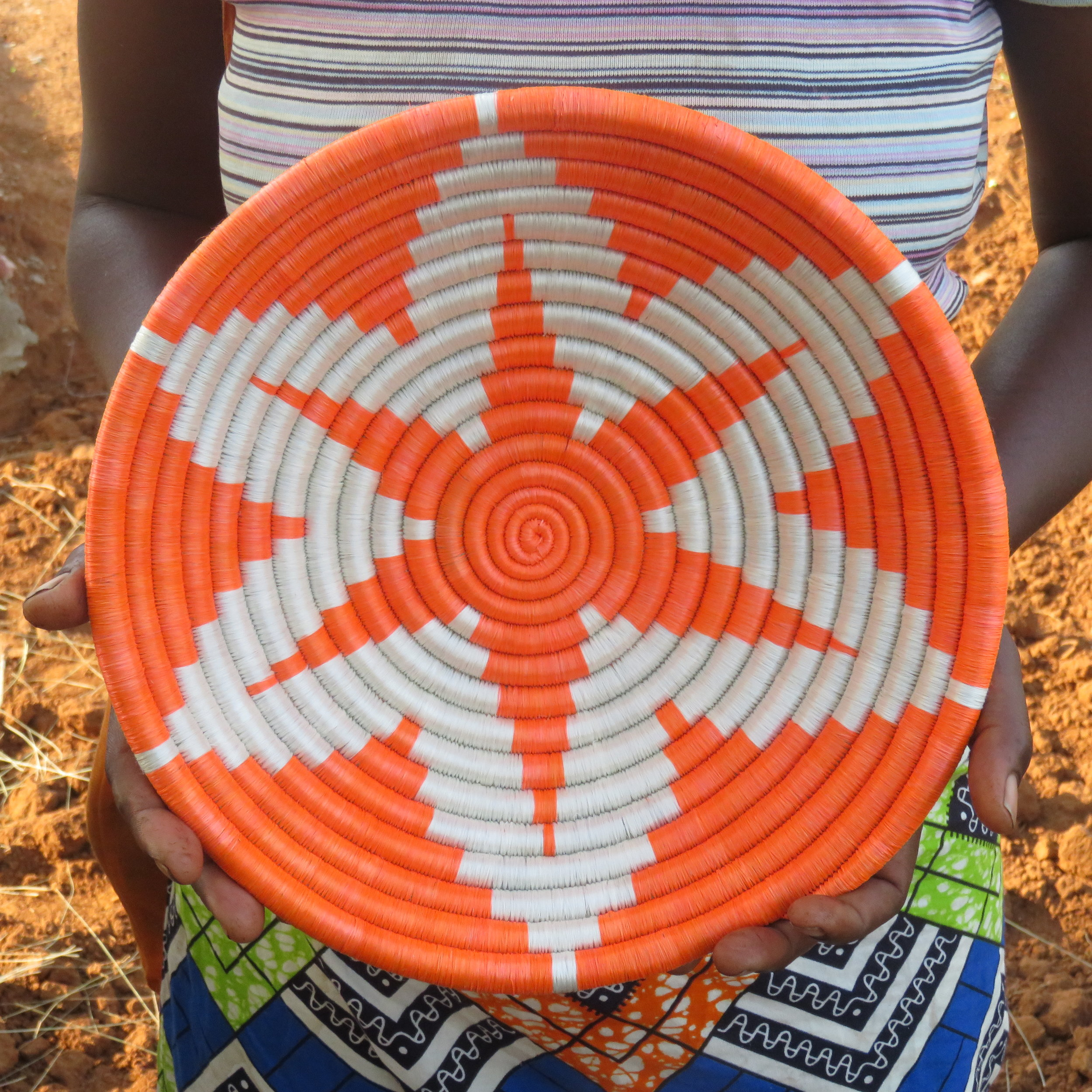 "Beautiful! The finished product.  A beautiful handcrafted orange and white ""six-pointed star"" bowl."