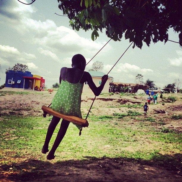 Teaching Benedicta how to swing.