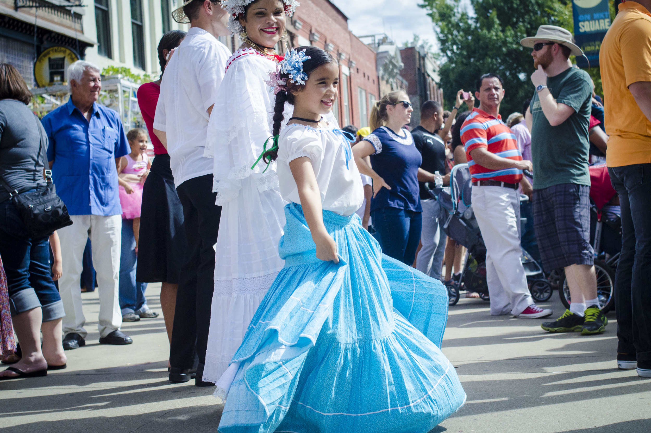 Camila Webb, 8,dances to popular hispanic music in Market Square.