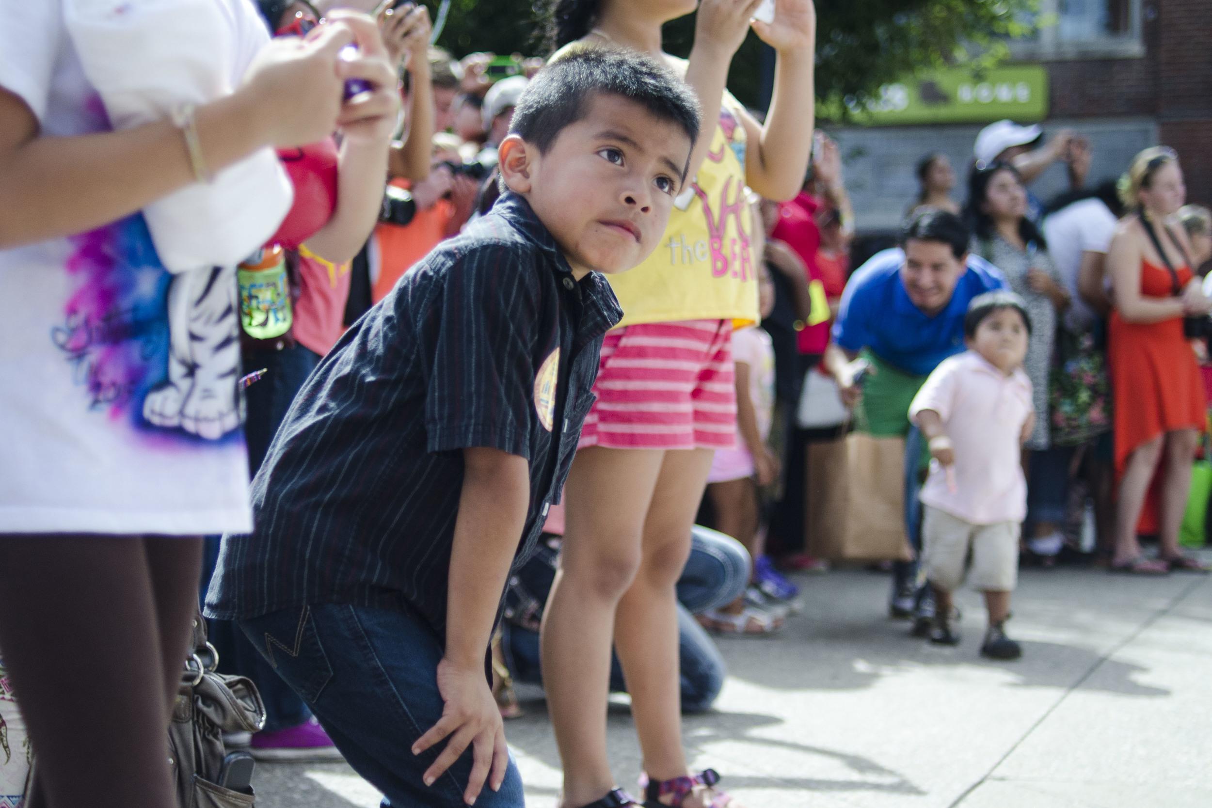 Samuel Betanco, 6,anticipates the parade's finale in Market Square.