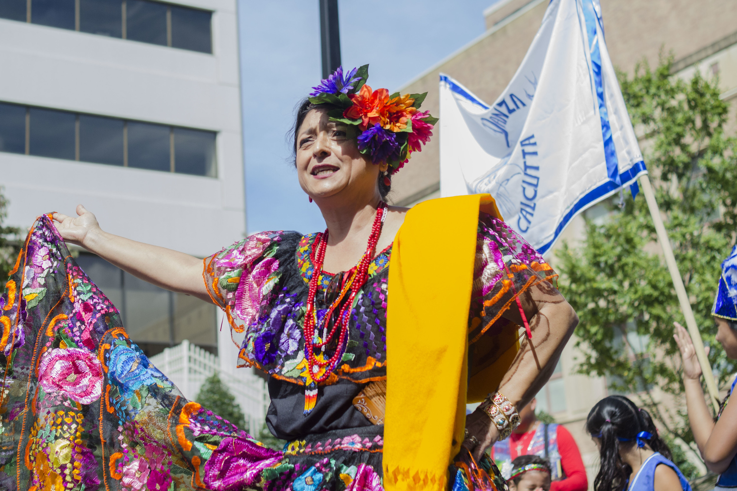 One main event is the Parade of Nations where representatives from each Latino country march down Gay Street and display their country's traditions and heritage. As the parade rounds Wall Avenue towards Market Square, Gabriella Tomás sings a Chilean pride song.