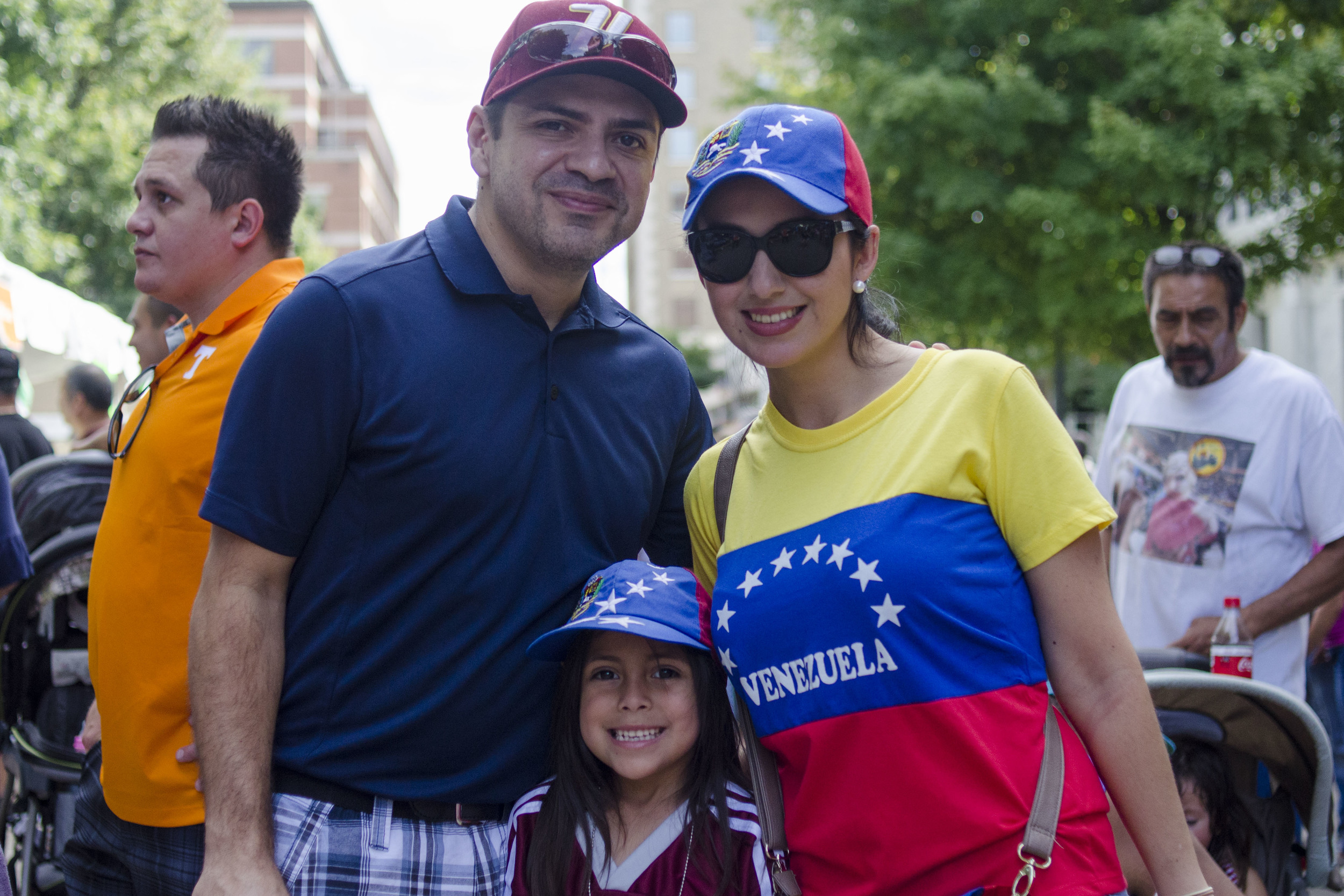 "Many families like Jeff (left) and Yorya (right) Perez's family enjoy the Hola Festival because of it's ""feeling of home,"" according to Yorya. After moving to Knoxville from Venezuela a year ago, Sofia (middle) says that she wants to return every year."