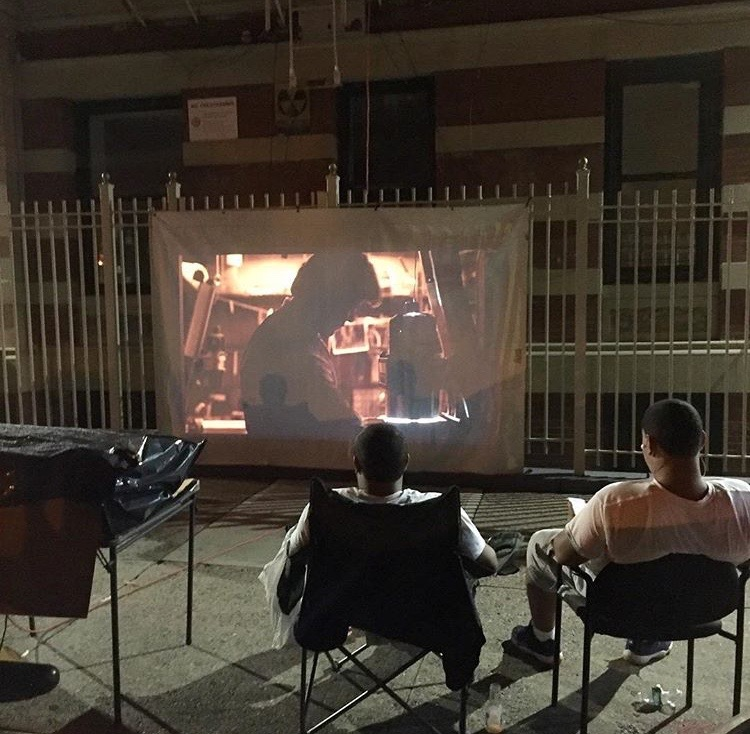 @pjp1717Watching a video in front of the building at 101st & Manhattan Avenue #makingplaceuws