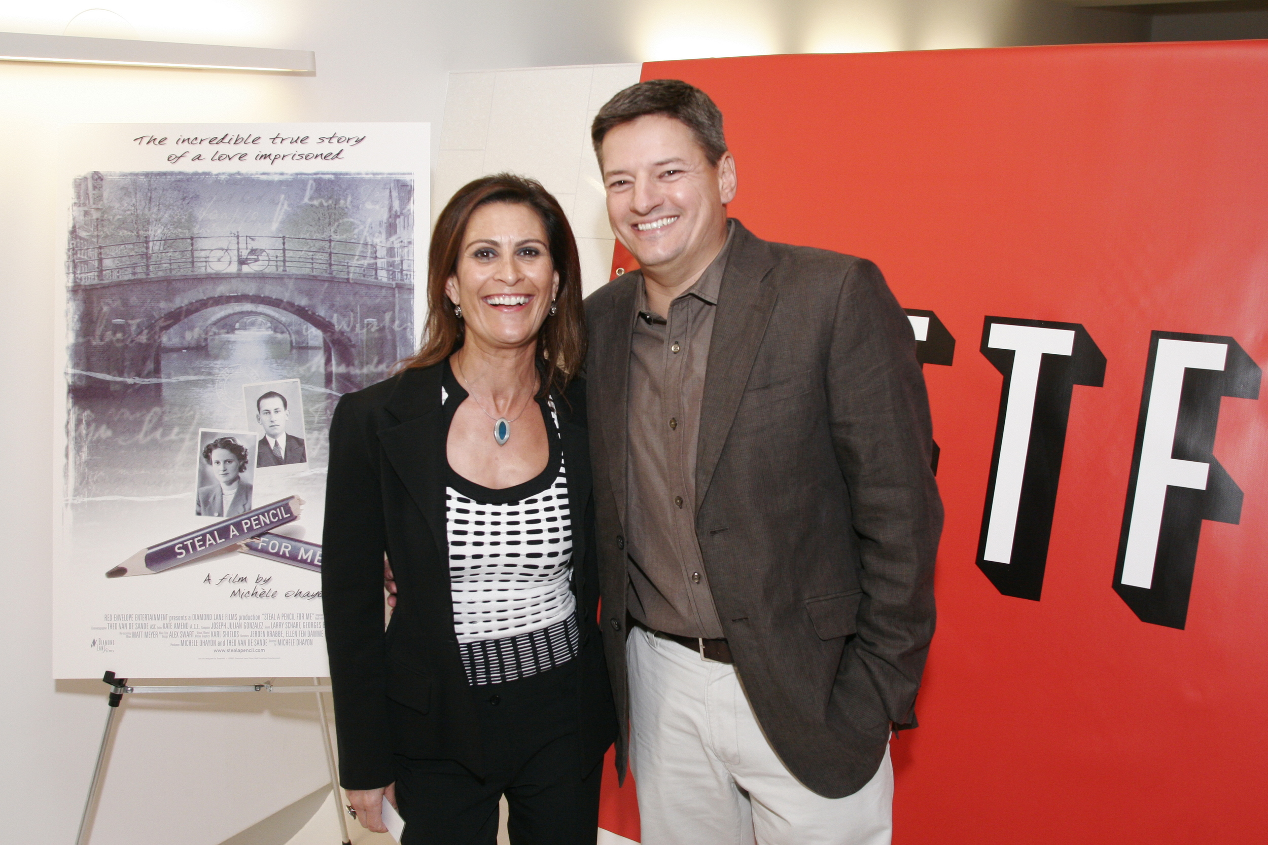 """With Ted Sarandos of Netflix, at their premiere of Michele's Film """"Steal a Pencil for Me"""""""