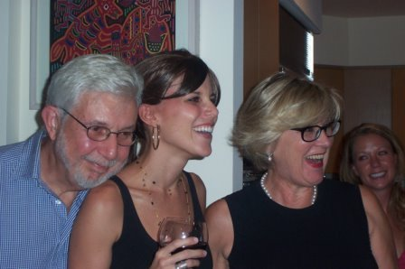 Alexis Saunders (center) with her parents.