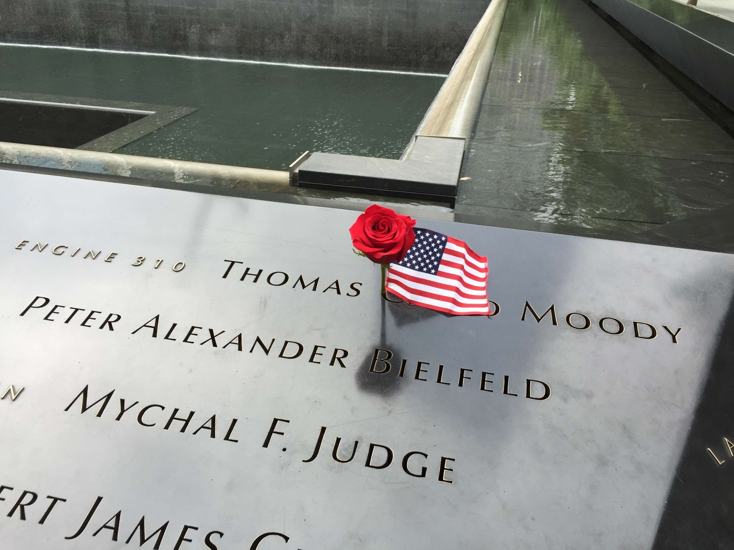 American flag and flower placed on the name of a victim from the New York Fire Department (click to enlarge)