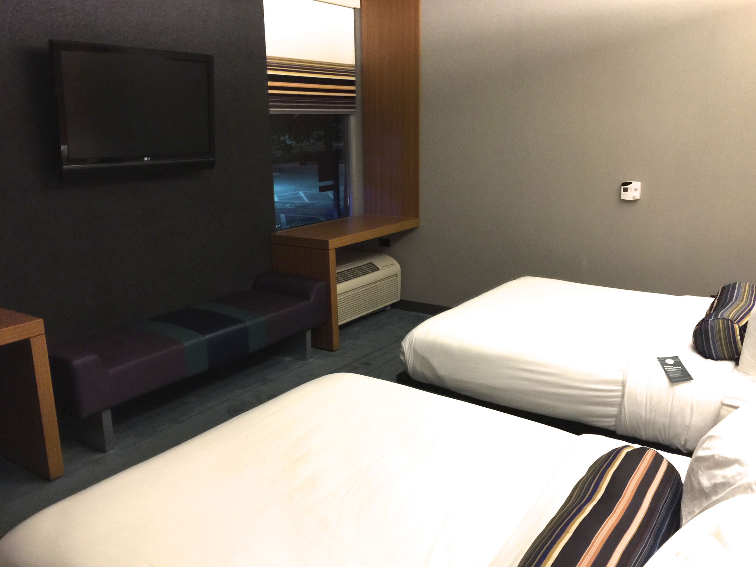 Sleeping area featuring queen platform beds and a bench seat  (click to enlarge)