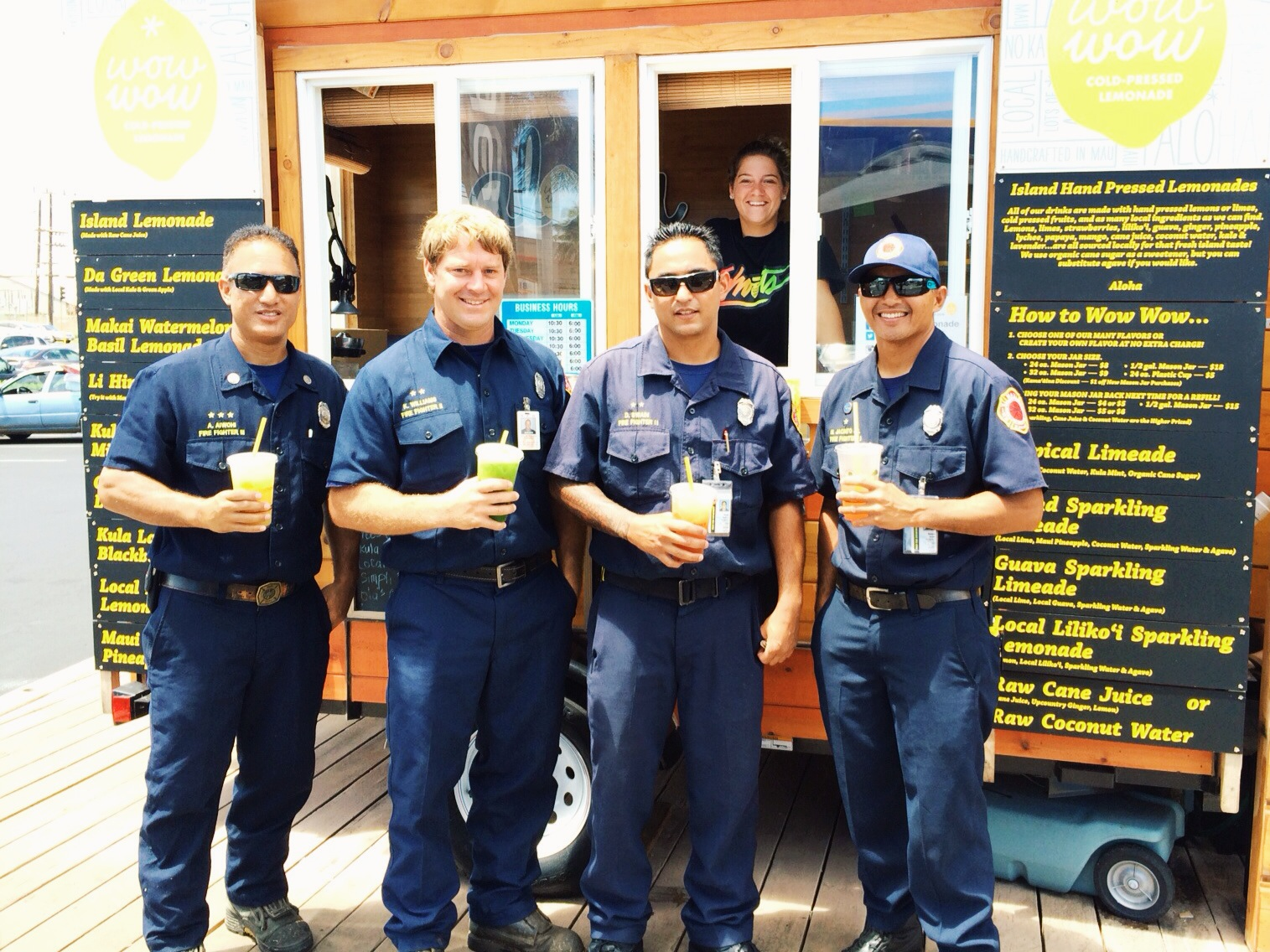 Local fire fighters cooling off with a few refreshing lemonades at our stand in Kahului.
