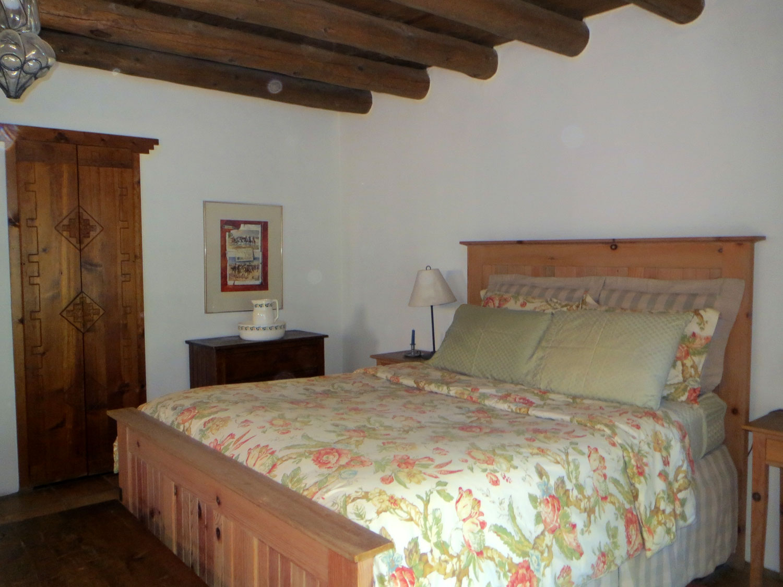 Bedroom of the B&B suite showing ceiling vigas