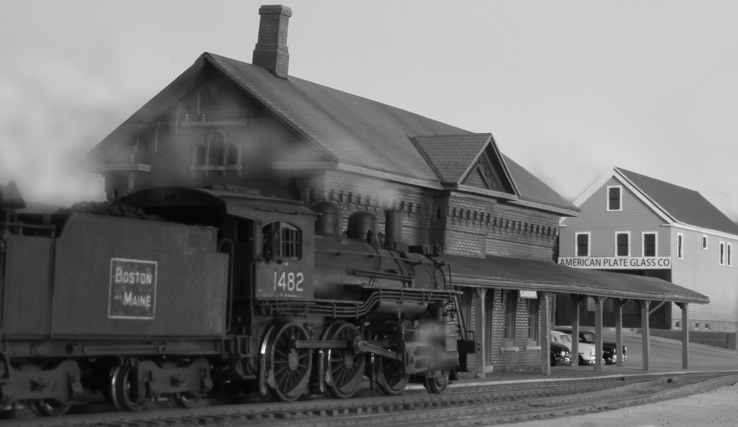 Model. B&M No. 1482 (2-6-0) Class B heads east towards Concord as it passes Claremont station.    2-6-0 – Overland. Photo effects - GIMP editor. Submitted by Bernie Brown, Aug. 19, 2014. Boston & Maine Railroad Historical Society Archives digital image. Photo 432