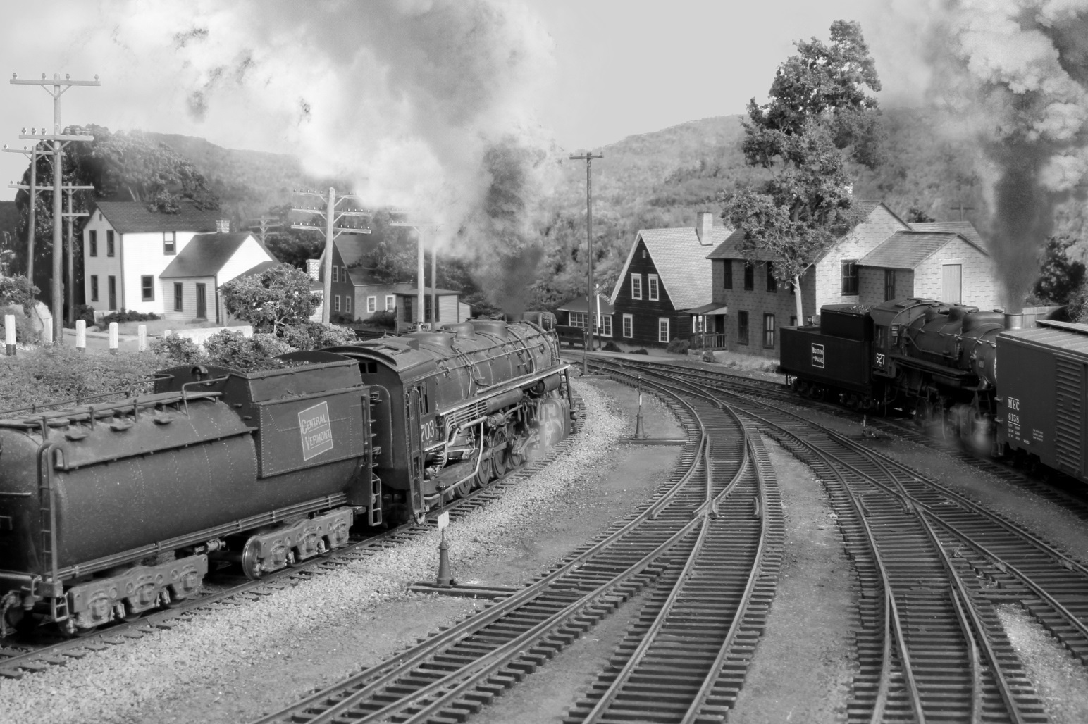 Model of B&M No. 627 (0-8-0) Class H working the north end of the White River Junction yard while CV 2-10-4 No. 703 heads towards the nearby Central Vermont yard. No. 627 - Proto 2000, re-detailed and renumbered. No. 703 - Pacific Fast Mail. Submitted by Bernie Brown, Nov. 7, 2014. Boston & Maine Railroad Historical Society Archives digital image. Photo 433