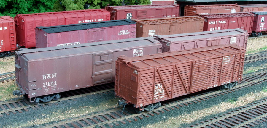 Three of the 2,000 XM-1 boxcars built for the B&M in 1929-1930.  The two types of roofs used are shown: the raised outside rib roof and the flat inside carline roof.  All the cars in the photo were built from kits by Edward J. Ozog. Photographed and submitted by Mr. Ozog. Photo 799