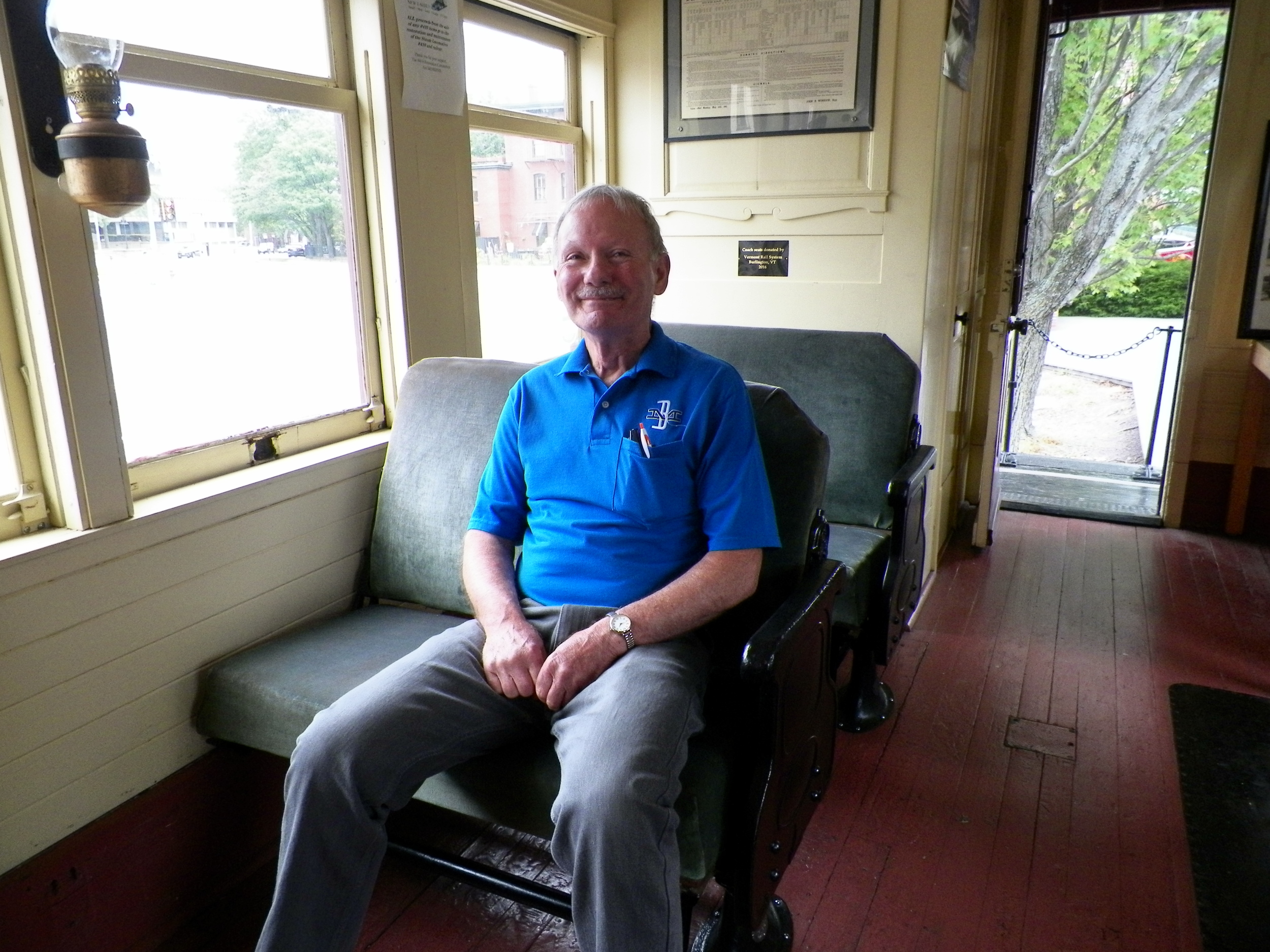B&MRRHS volunteer Mal Sockol tries out new coach seats recently donated to B&MRRHS by Vermont Rail System. Richard Nichols photo