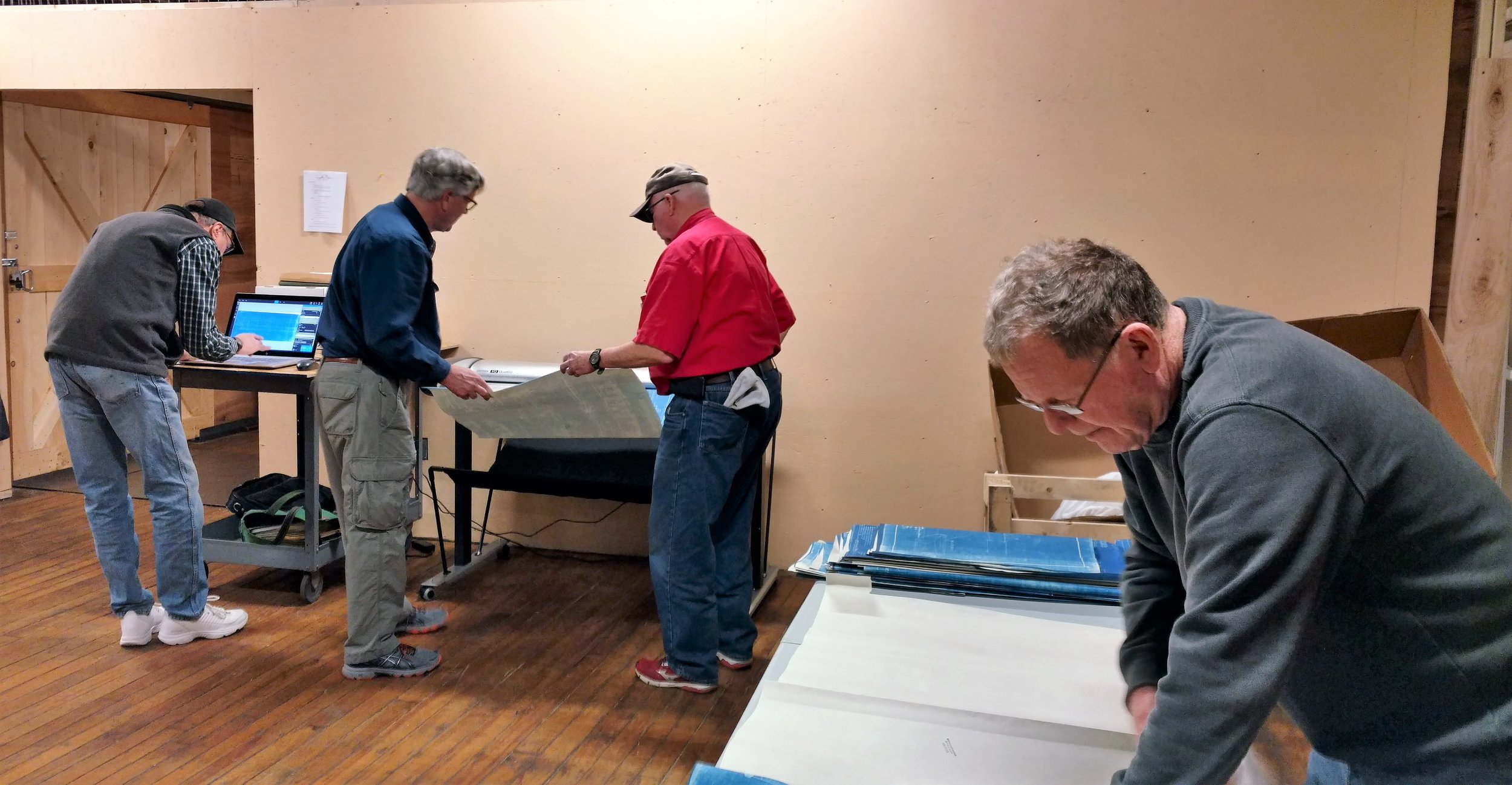 March 31, 2018. Archives work session devoted to moving storage boxes into the new space and to trying out our new continuous feed scanner. The scanning crew is pictured here. Left to right: Jimi Smith, Coley Walsh, Jack madden, and Bob Farrenkopf. Dan Hyde photo