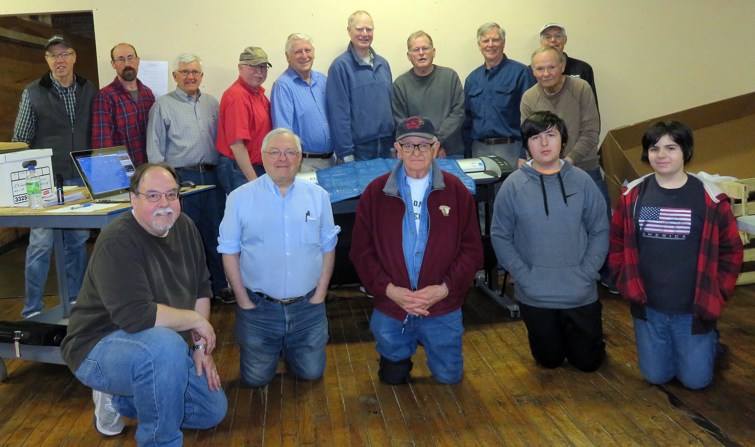 Archives Committee members pause for group shot during work session at North Chelmsford on March 31, 2018. Front row left to right Alan lePain, Rick Hurst, Society President Dan Hyde, Matthew LePain, and Caleb LePain. Back row Jimi Smith, Earl Tuson, Rick Nowell, Jack Madden, Carl Byron, Brad Blodget, Bob Farrenkopf, Coley Walsh, Mal Sockol, and Rick Conard. Alan LePain photo.