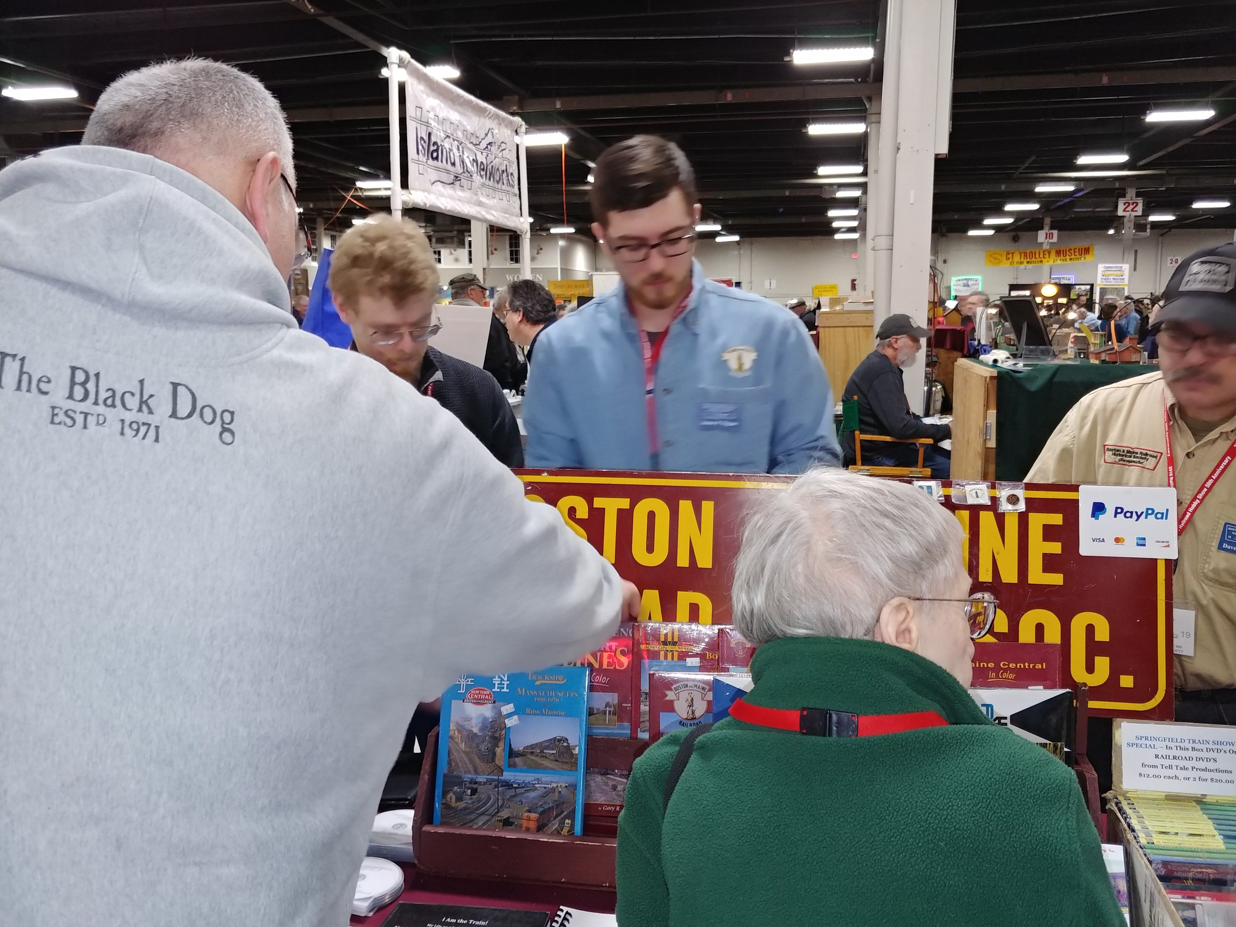 Rick Kfoury (left), Jimmy Nigzus, and Dave Hampton man the tables at the Amherst Railroad Society Show at West Springfield on January 27, 2019. Staff Photo