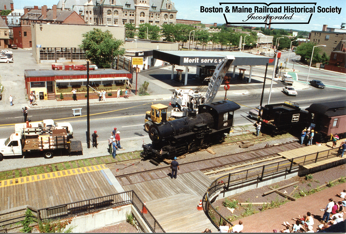 July 18, 1993 - Once the extra arrived at the industrial track in downtown Lowell along Dutton Street, #410 was moved by crane into place on an adjacent display track with combine coach No. 1244. Ed Felten photo, courtesy Jim Nigzus Collection.