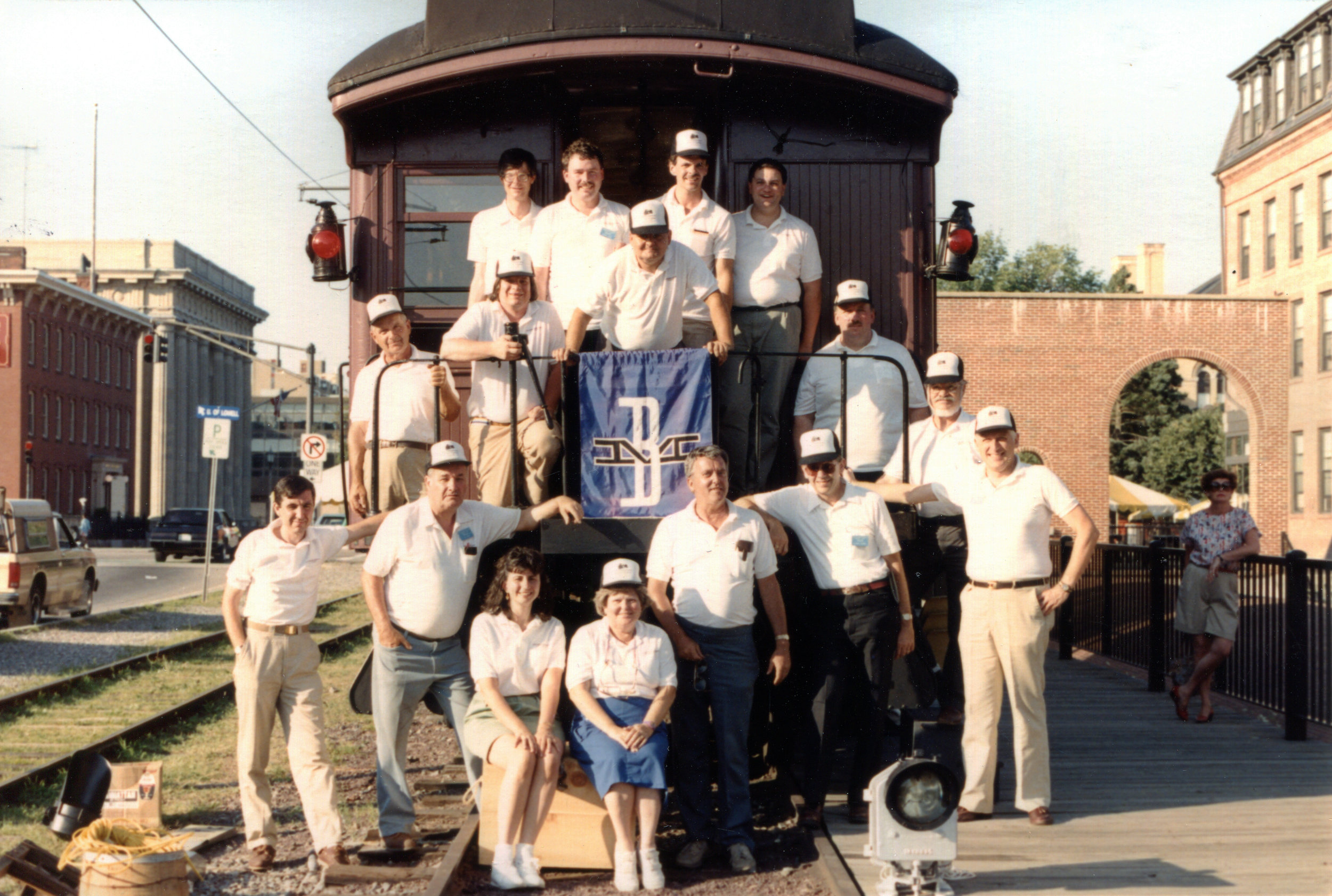 Lowell, MA, 1993. B&MRRHS volunteers and members pose on the rear of combine coach No. 1244.