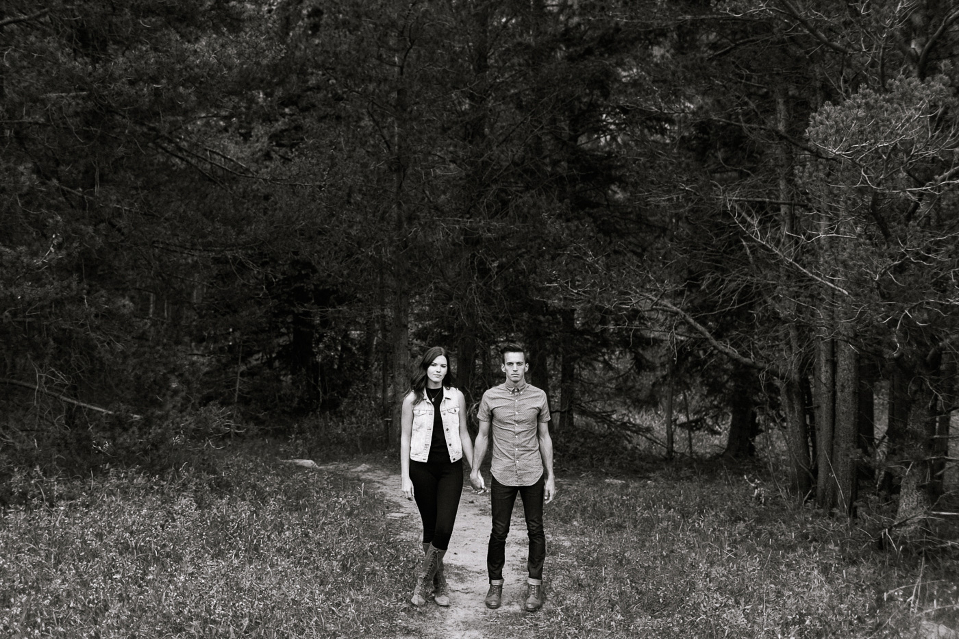 Couple Holding Hands Beside Forest in Black and White