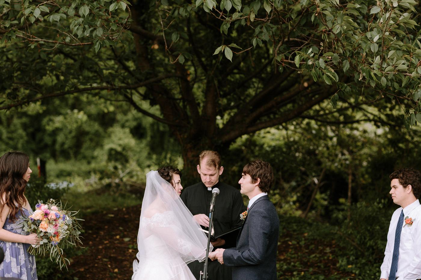 Bride and groom backyard wedding ceremony
