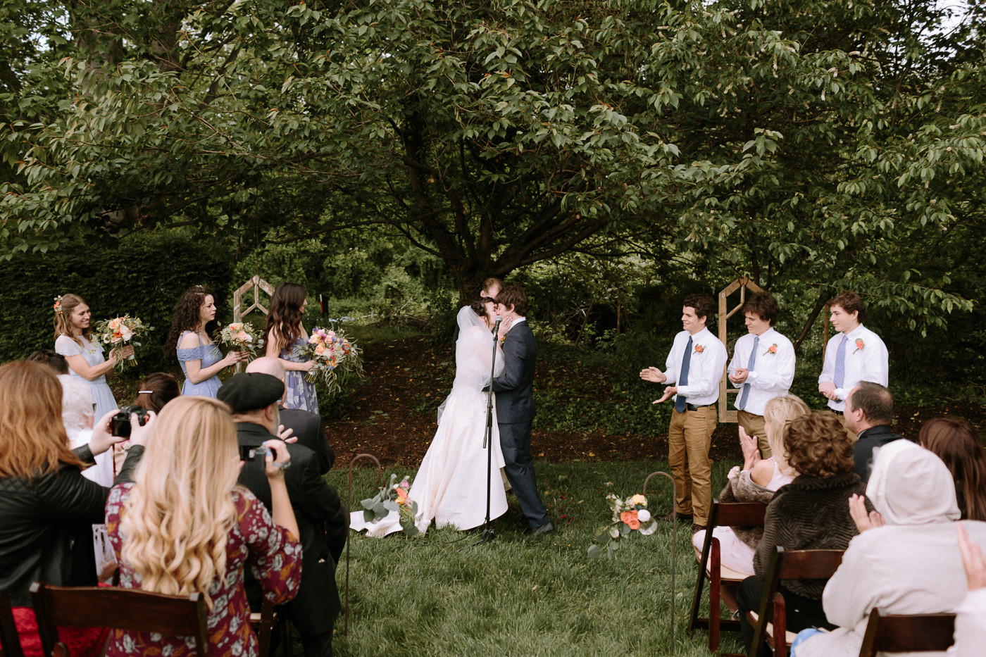 First kiss backyard wedding