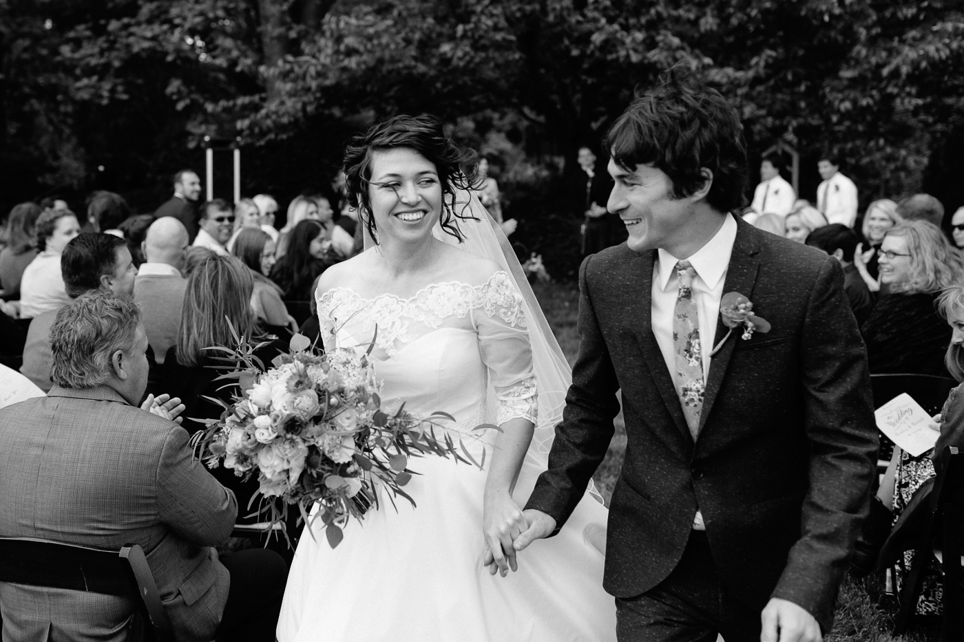 Bride and groom smiling recessional
