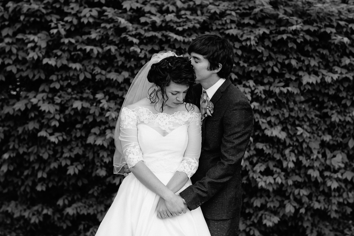 Bride and groom black and white with leaves