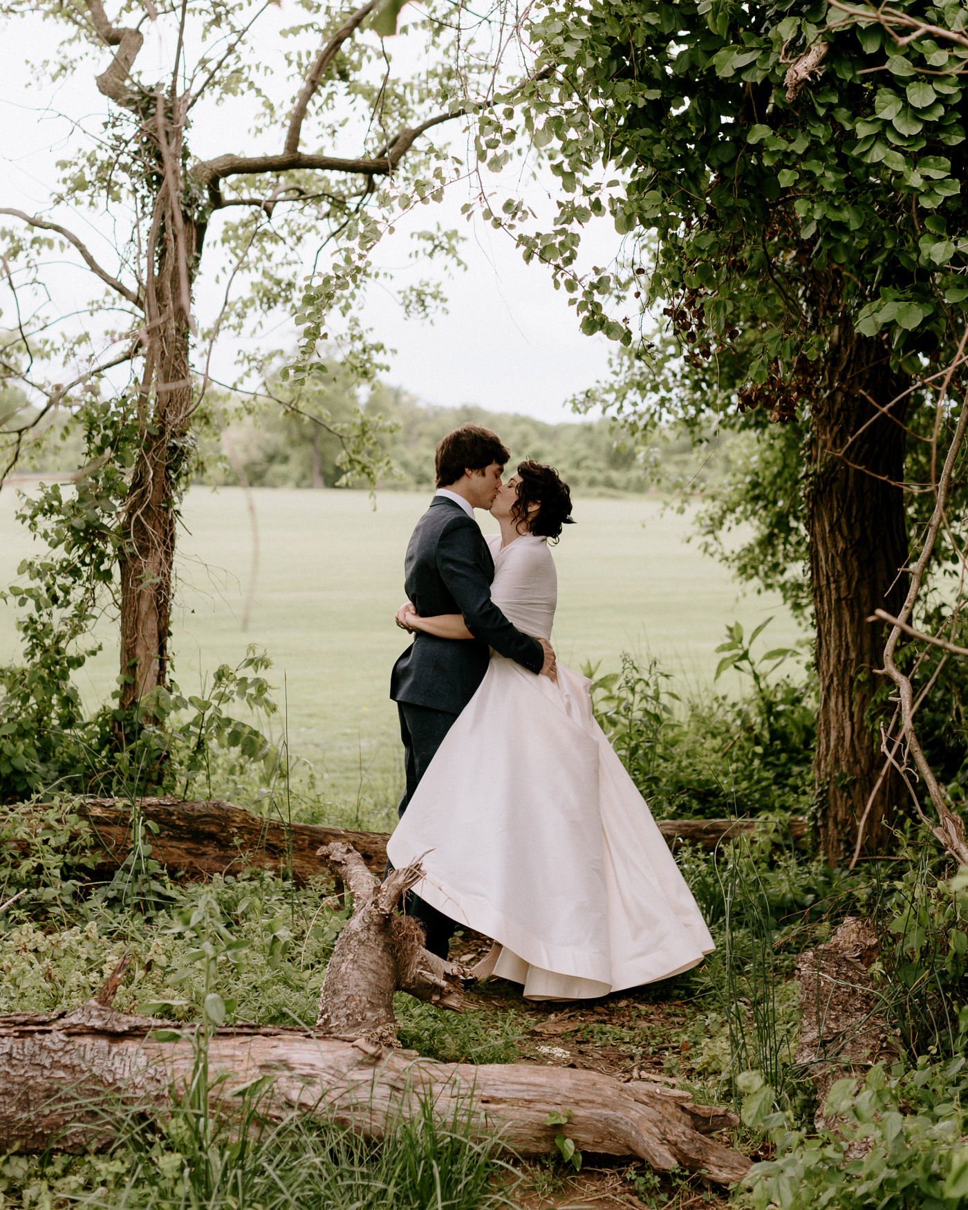 Bride and groom in forest kissing