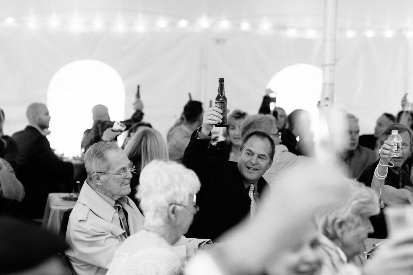 Father of the groom raising a glass