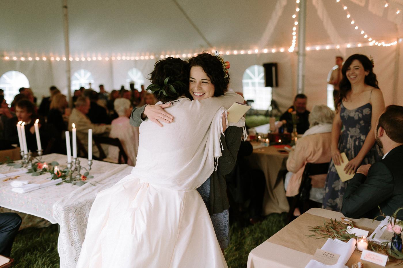 Bride hugging sister