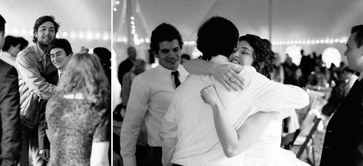 Bride and groom hugging friends