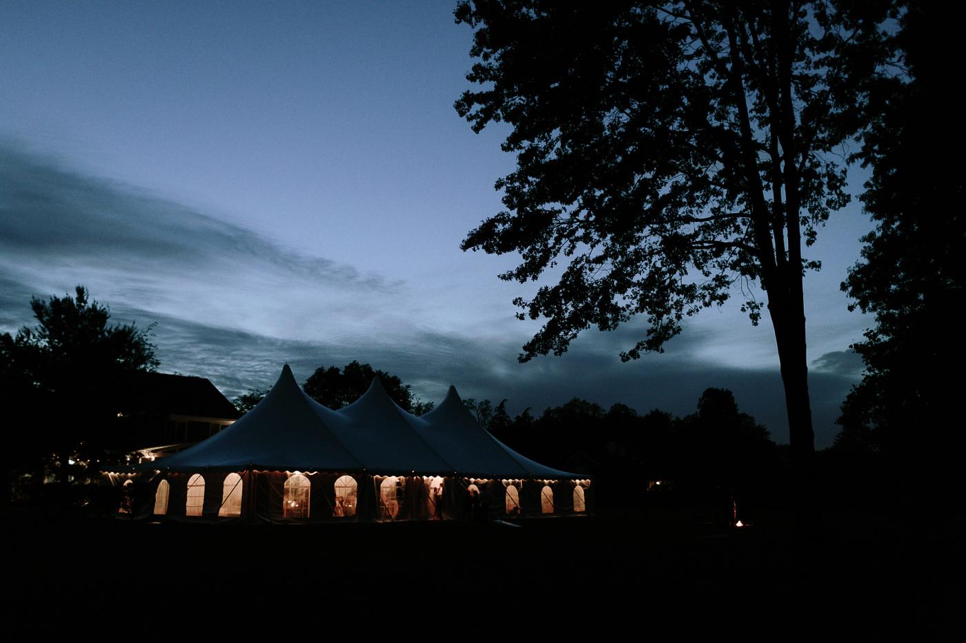 Backyard wedding reception at dusk