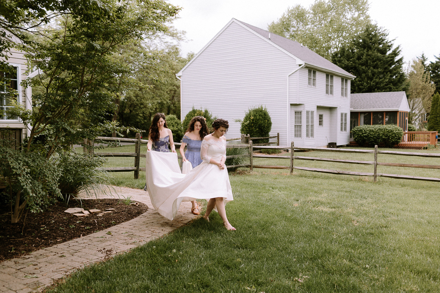 Bride and sisters first look