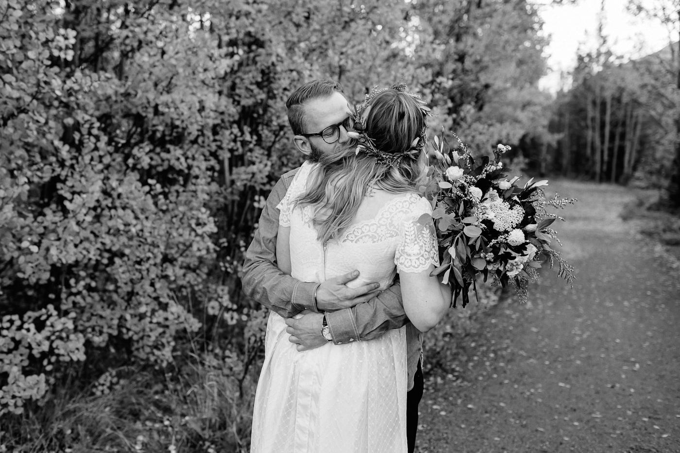 First look bride hugging groom