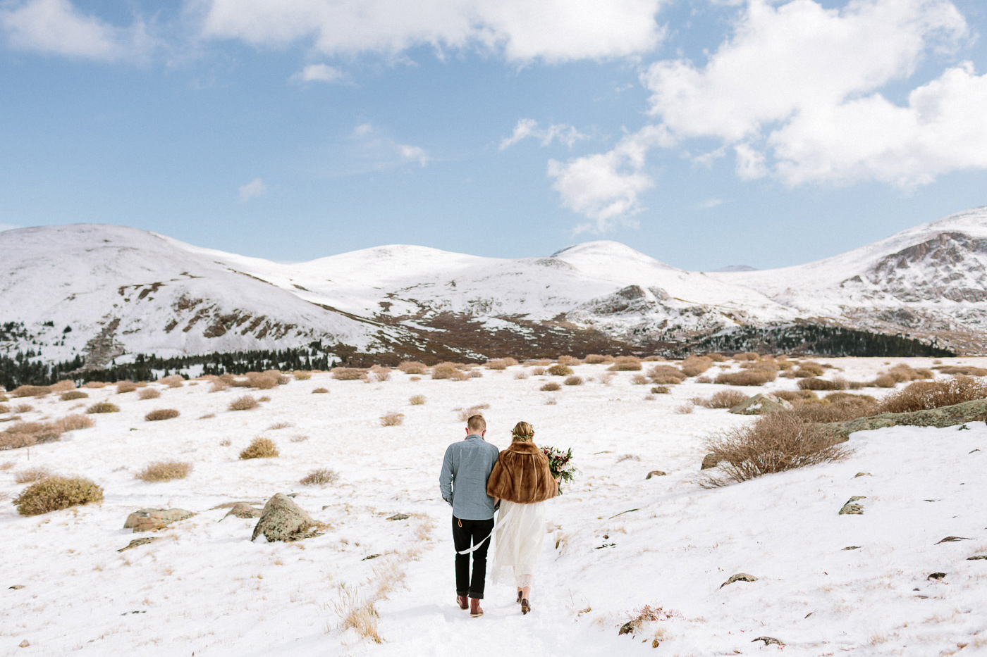 Guanella Pass bride and groom walking