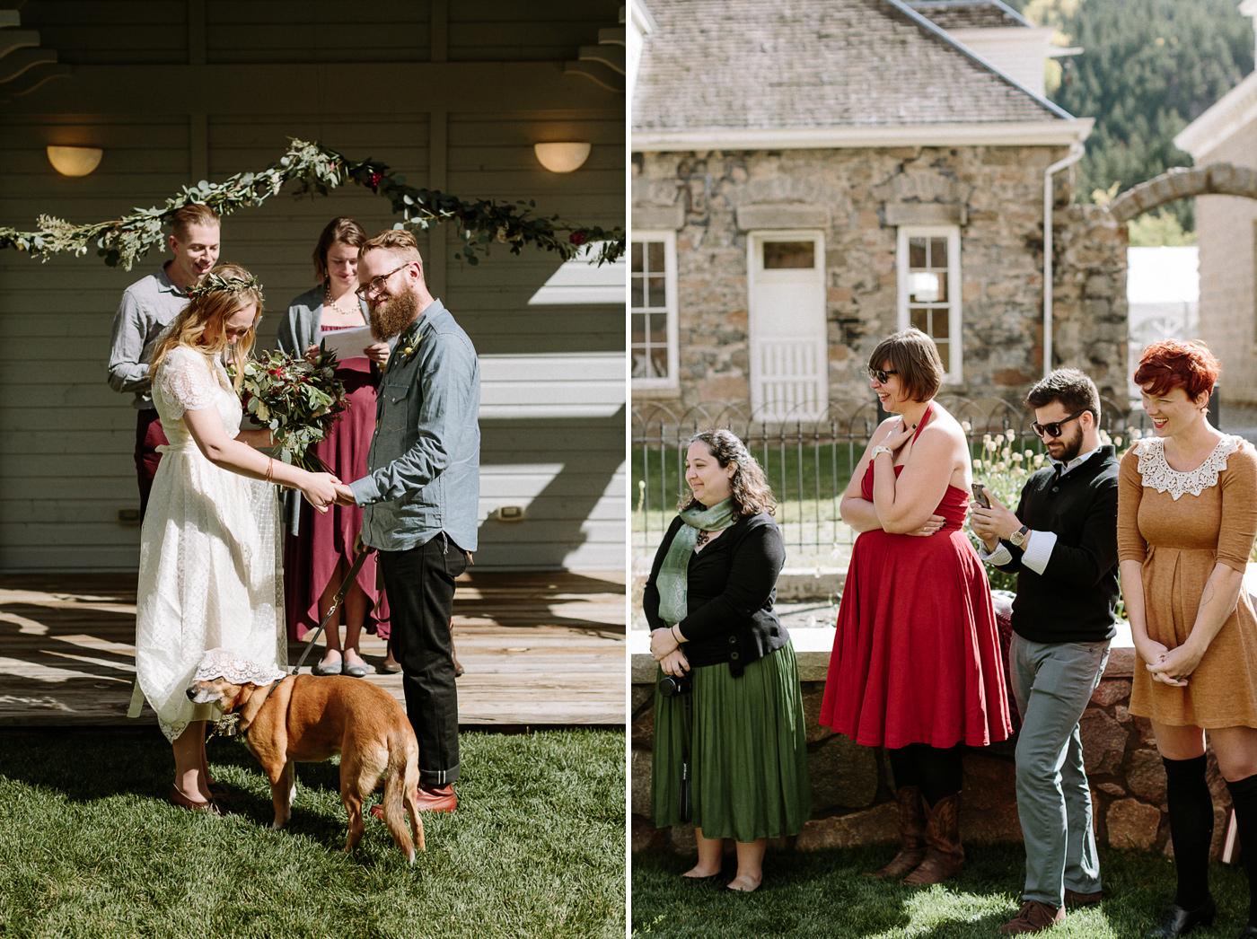 Dog under bride's wedding dress during ceremony