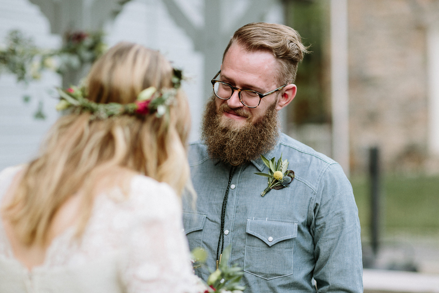 Groom smiling through tears during vows